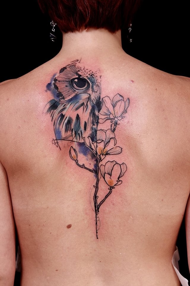 Illustrative style colored back tattoo of owl with flowers