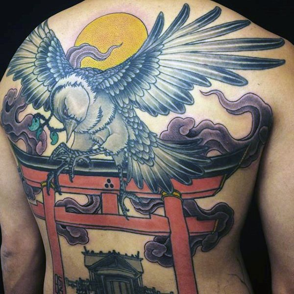 Illustrative style colored back tattoo of big bird with temple and sun