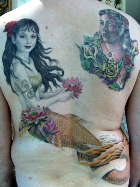 Illustrative style colored back tattoo of mermaid with woman portrait
