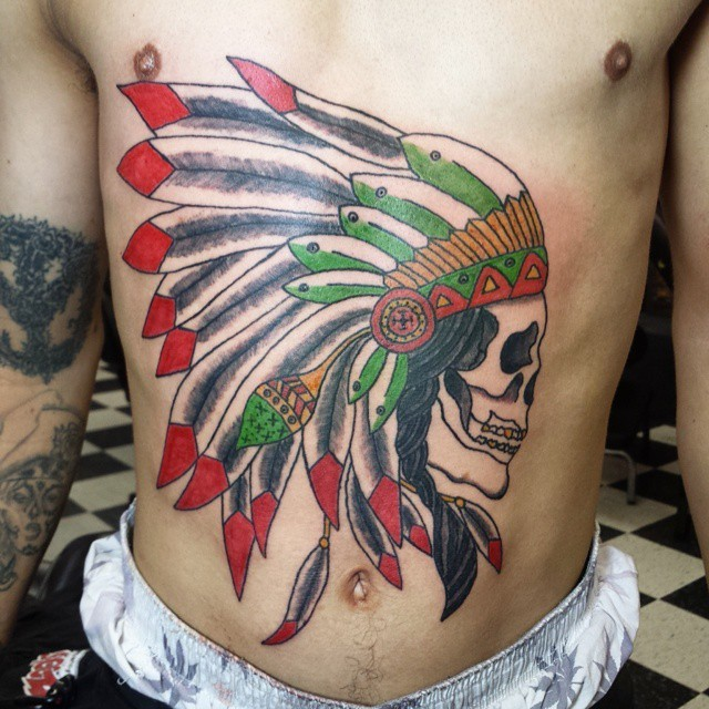 Illustrative style colored belly tattoo of Indian skull