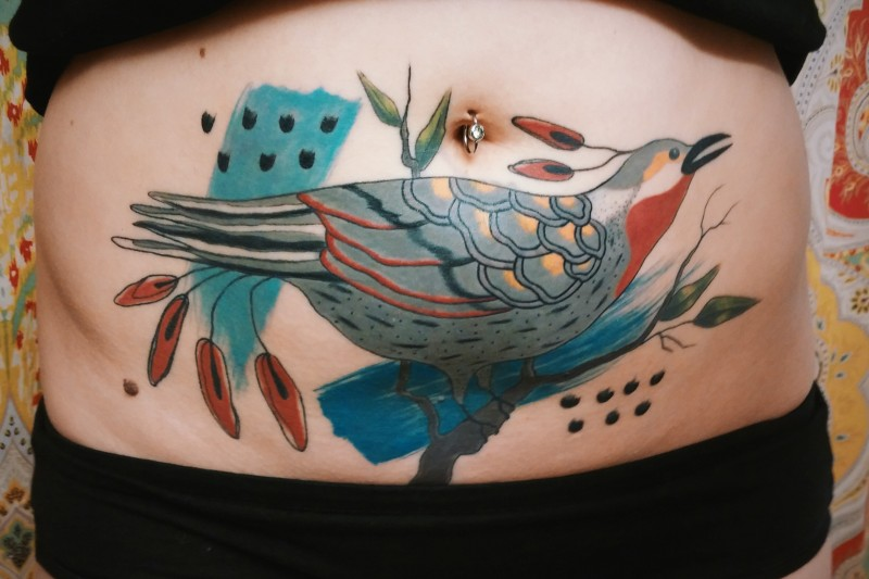 Illustrative style colored belly tattoo of bird