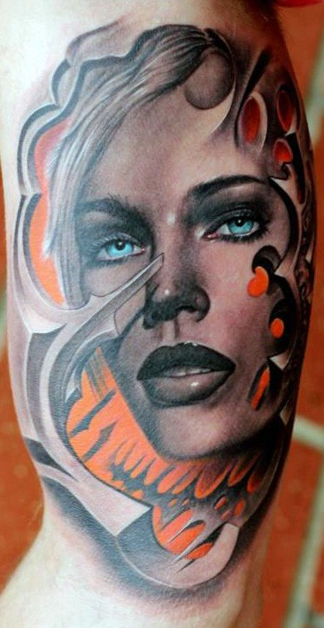 Illustrative style colored biceps tattoo of woman portrait with blue eyes