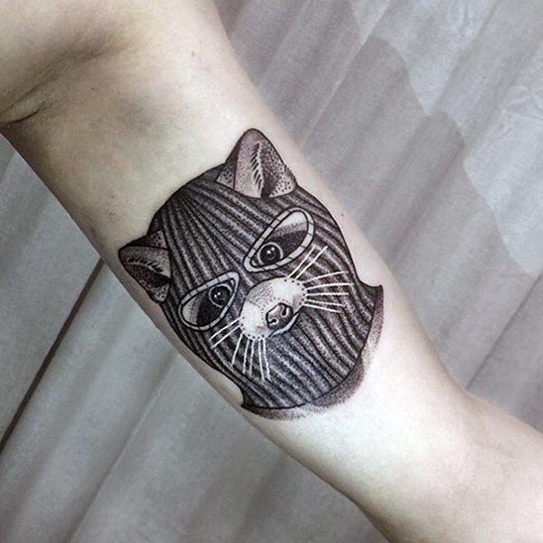 Illustrative style colored biceps tattoo of raccoon with mask