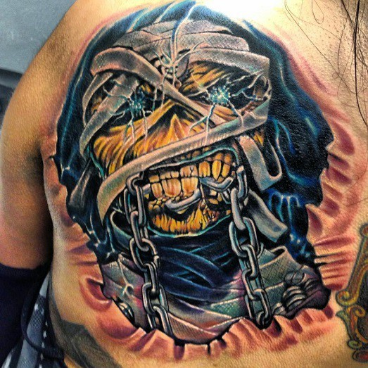 Illustrative style colored chest tattoo of creepy zombie with chain