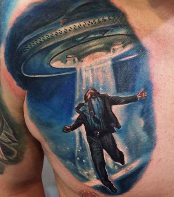 Illustrative style colored chest tattoo of alien ship stealing man in suit