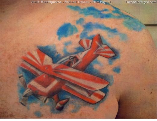 Illustrative style colored chest tattoo of nice looking jet