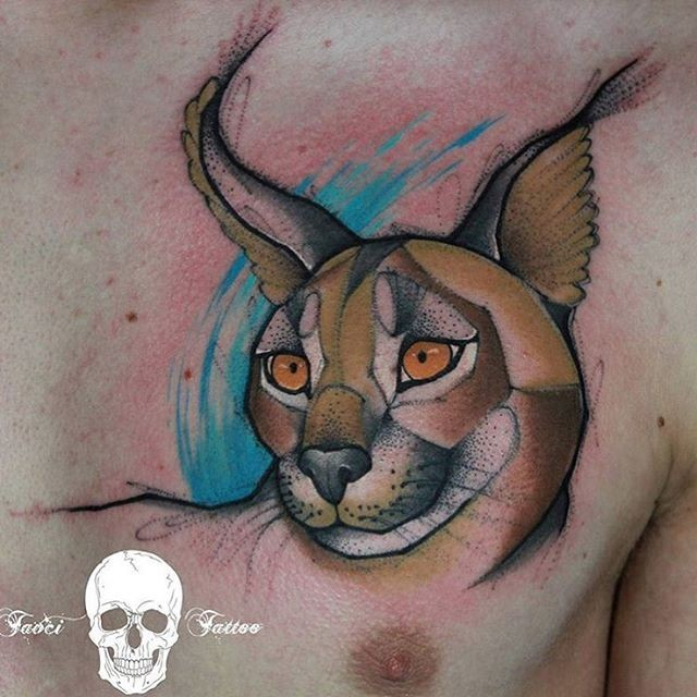 Illustrative style colored chest tattoo of caracal head