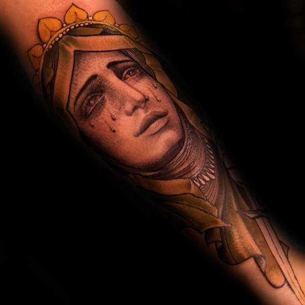 Illustrative style colored crying woman face tattoo on arm