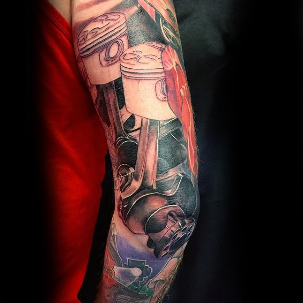Illustrative style colored engine pistons tattoo on shoulder