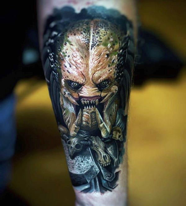 Illustrative style colored forearm tattoo of evil Predator