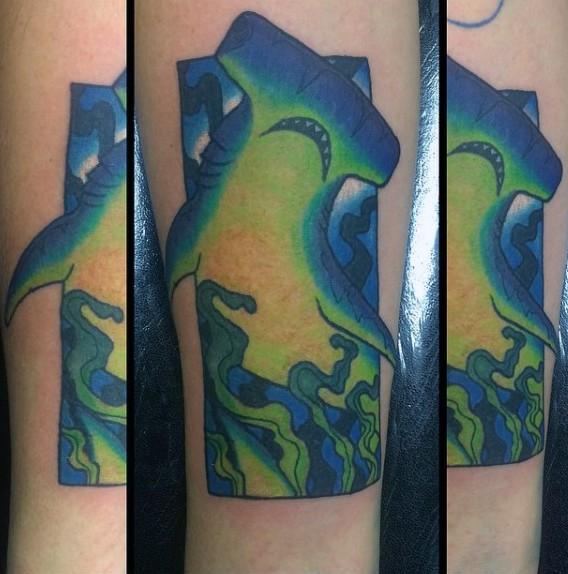 Illustrative style colored forearm tattoo of hammerhead shark