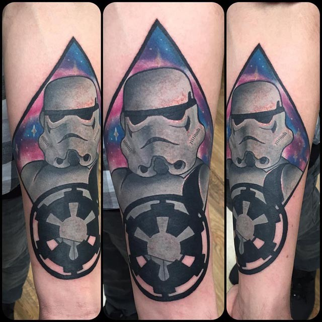 Illustrative style colored forearm tattoo of Storm trooper with emblem