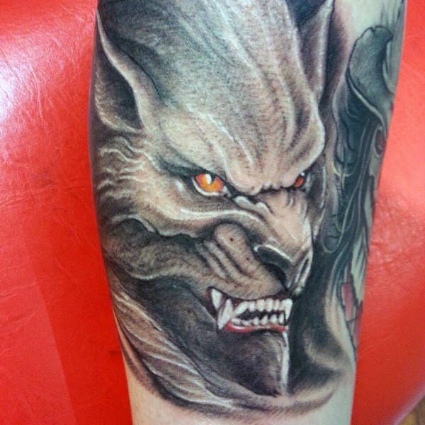 Illustrative style colored forearm tattoo of evil werewolf