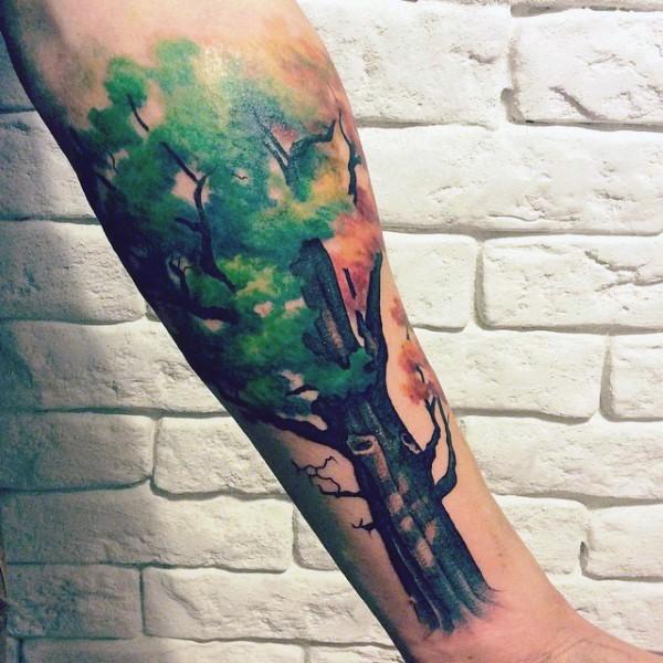 Illustrative style colored forearm tattoo of large tree