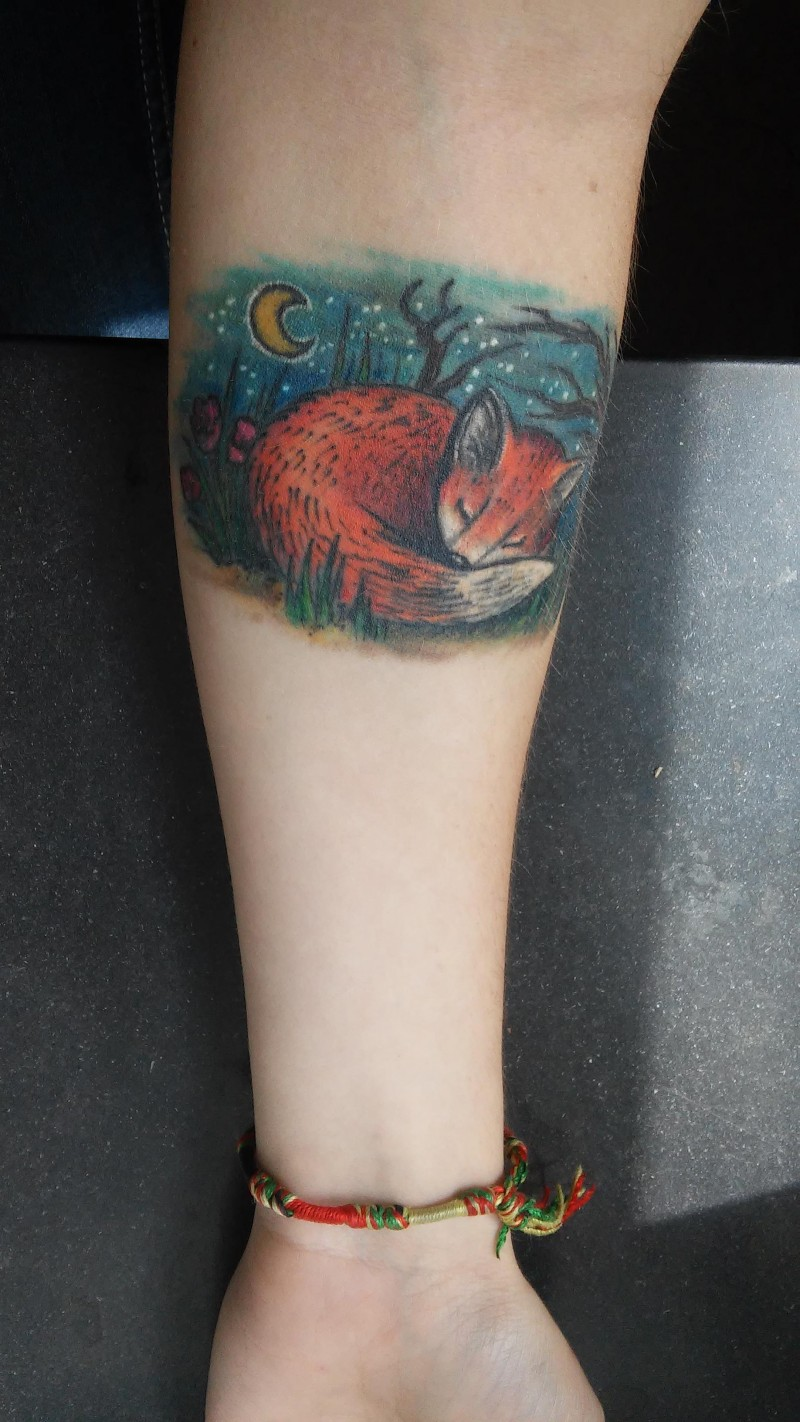 Illustrative style colored forearm tattoo of sleeping fox in night forest