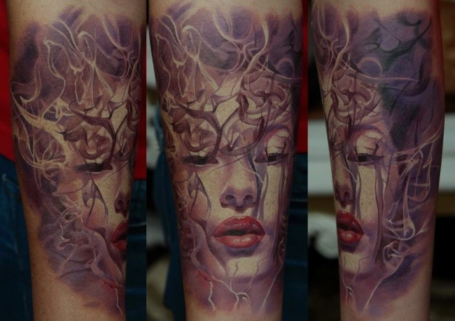 Illustrative style colored forearm tattoo of mystical woman portrait