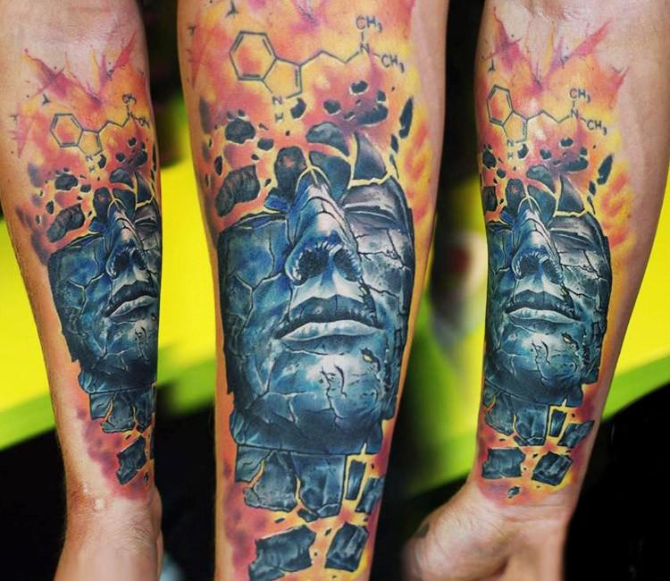 Illustrative style colored forearm tattoo of mystical man portrait