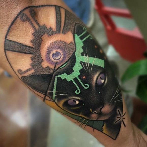 Illustrative style colored forearm tattoo of mystical cat