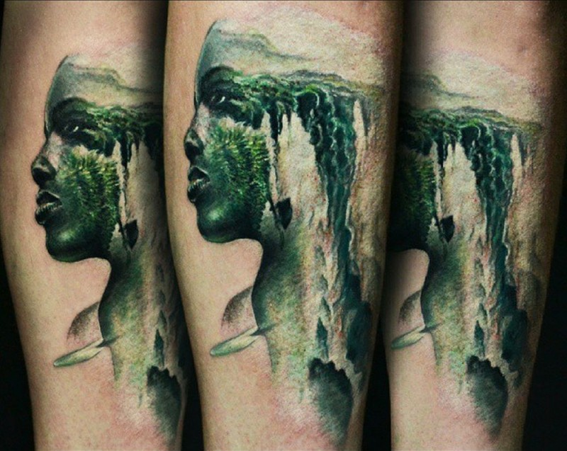 Illustrative style colored forearm tattoo of man portrait stylized with waterfall