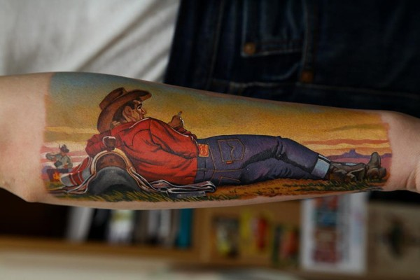 Illustrative style colored forearm tattoo of cowboy