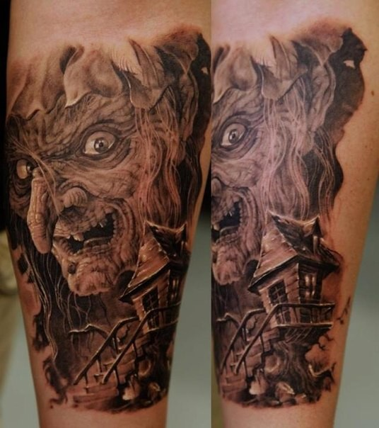 Illustrative style colored forearm tattoo of creepy witch with tree house