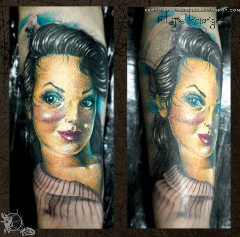 illustrative style colored forearm tattoo of cute woman doll