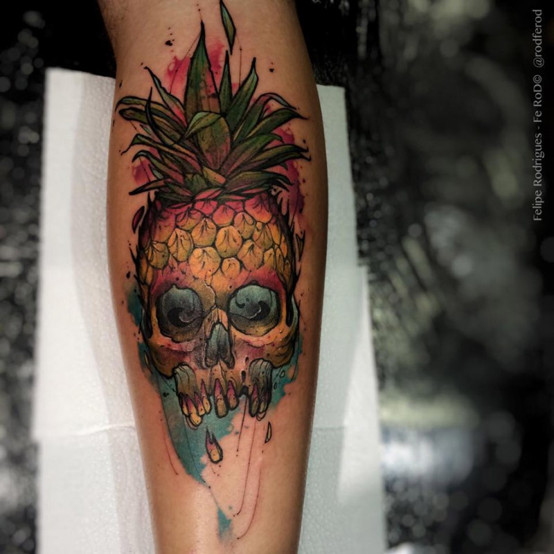 Illustrative style colored forearm tattoo of skull with pumpkin