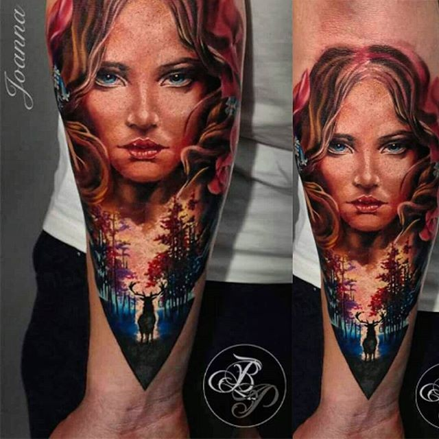 Illustrative style colored forearm tattoo of woman face with forest and deer