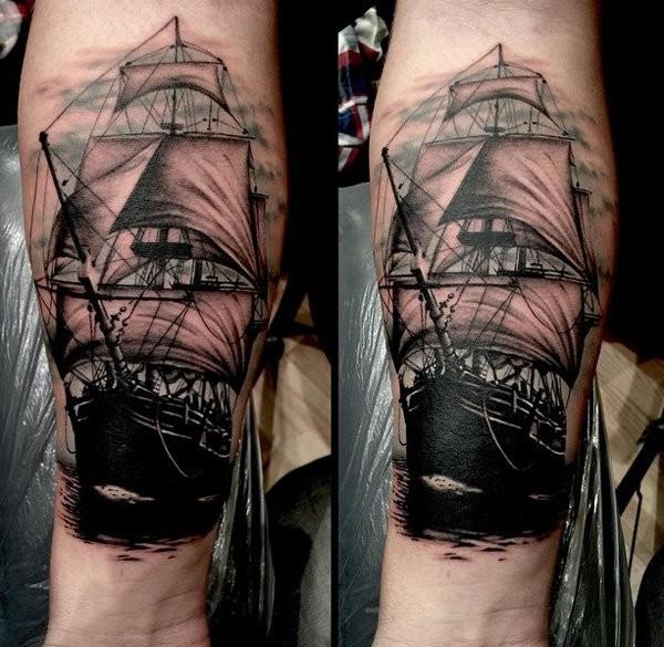 Illustrative style colored forearm tattoo of vintage sailing ship