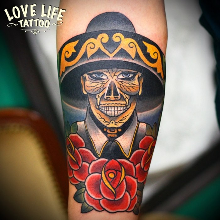 Illustrative style colored forearm tattoo of Mexican skeleton with rose
