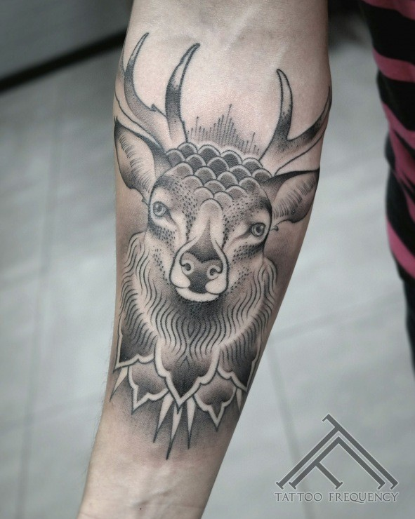 Illustrative style colored forearm tattoo of big deer