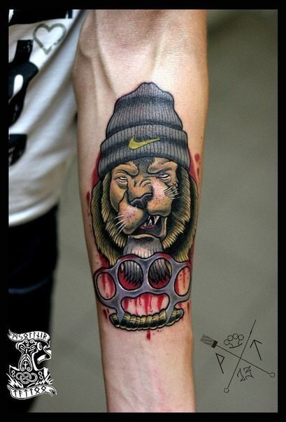 Illustrative style colored forearm tattoo of lion thug ...
