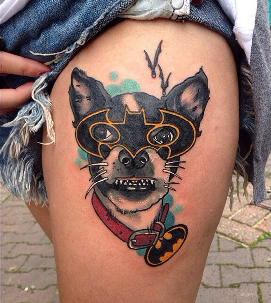 Illustrative style colored funny looking thigh tattoo of dog with Batman mask