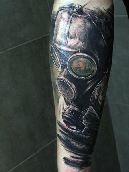 Illustrative style colored gas mask tattoo on forearm