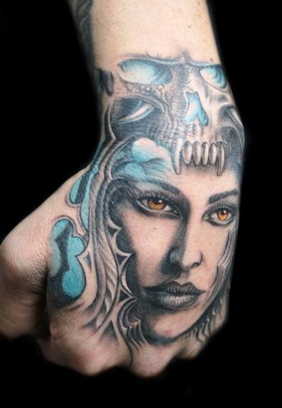 Illustrative style colored hand tattoo of fantasy woman face with skull