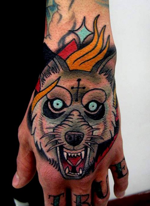 Illustrative style colored hand tattoo of evil wolf with cross and flames