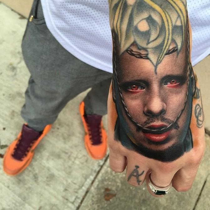 Illustrative style colored hand tattoo of mystic man portrait