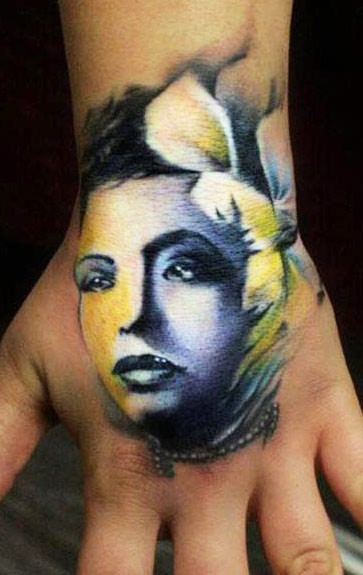 Illustrative style colored hand tattoo of woman with flowers