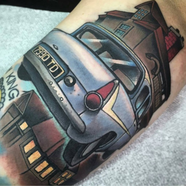 Illustrative style colored Harry Potter movie flying car tattoo on arm