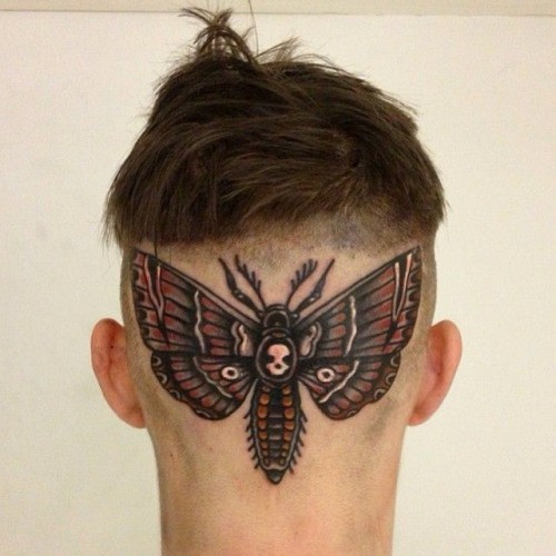 Illustrative style colored head tattoo of cool butterfly stylized with human skull