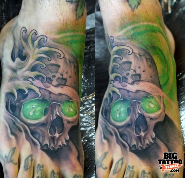 Illustrative style colored human skull tattoo on foot with radiation symbol