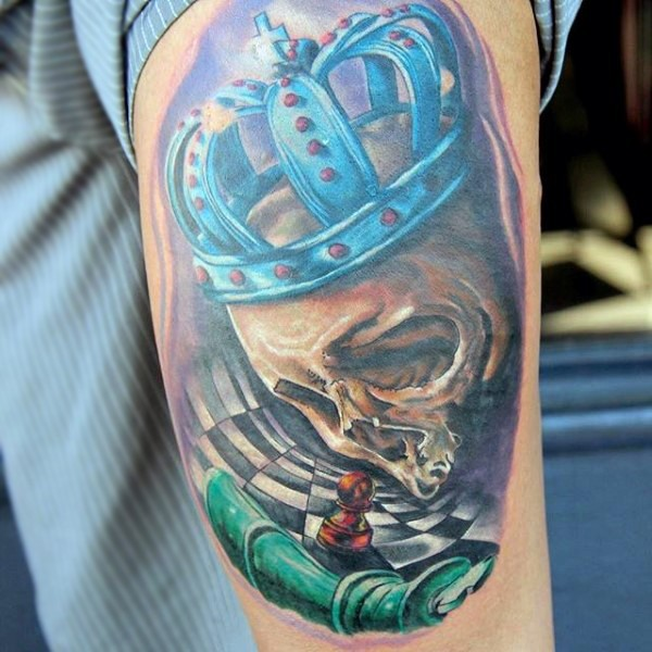 illustrative style colored king skull with crown tattoo on shoulder