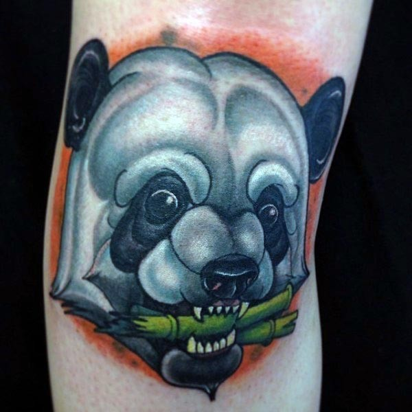 Illustrative style colored leg tattoo of panda head with bamboo