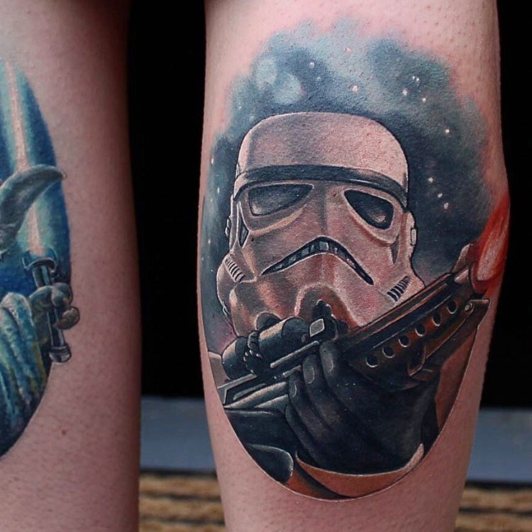 Illustrative style colored leg tattoo of Storm trooper with blaster