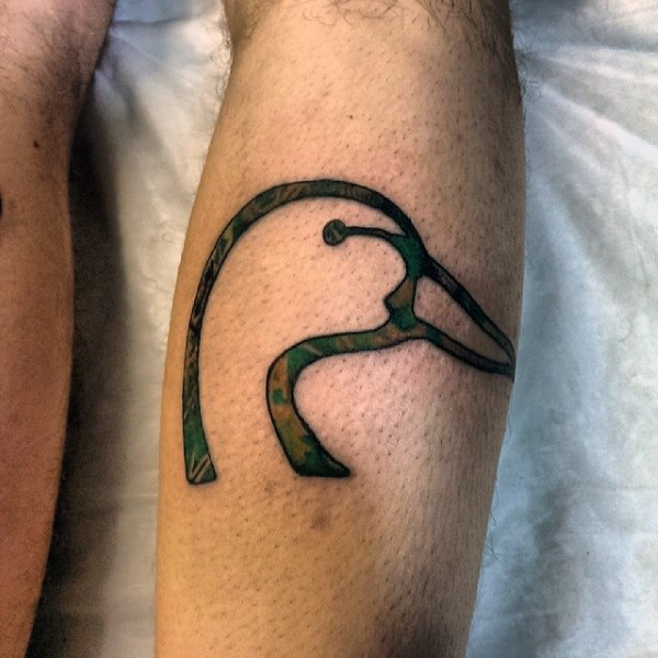 Illustrative style colored leg tattoo of swan head