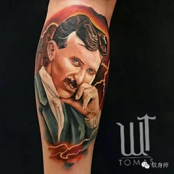 Illustrative style colored leg tattoo of Nikola Tesla