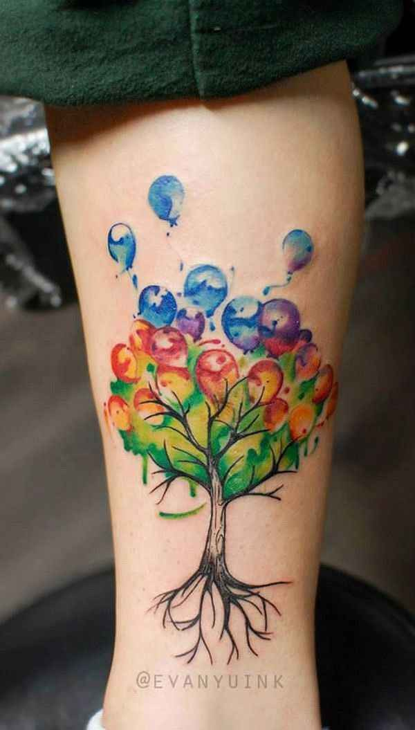 Illustrative style colored leg tattoo of tree with balloons