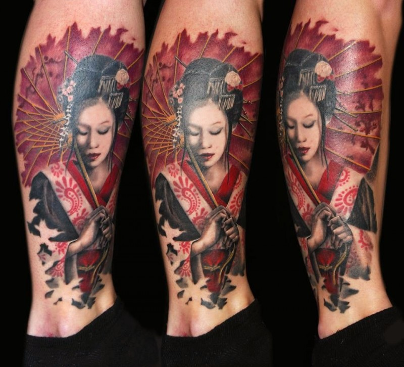Illustrative style colored leg tattoo of geisha with leaves