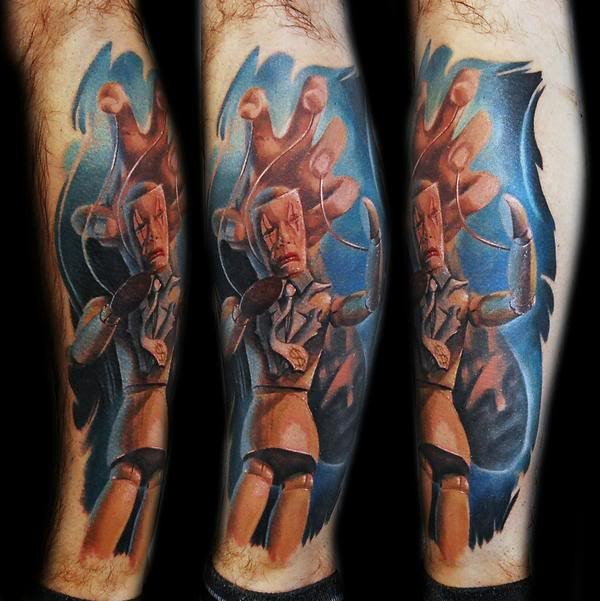 Illustrative style colored leg tattoo of creepy wooden puppet