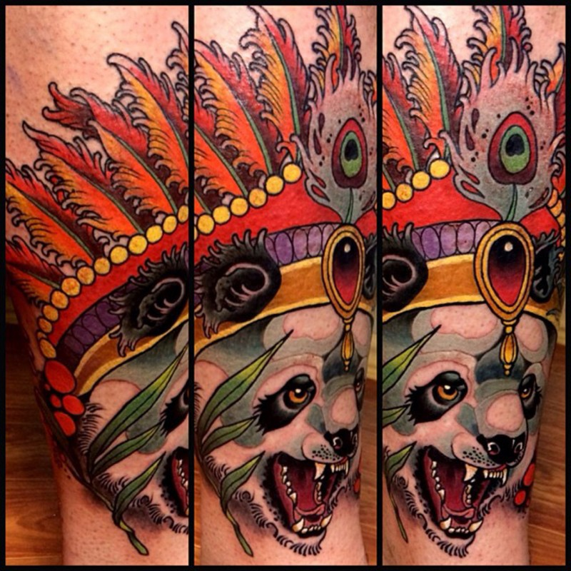Illustrative style colored leg tattoo of evil panda bear with cool helmet